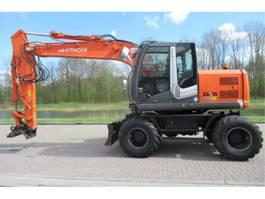 wheeled excavator Hitachi ZX140W-3 2010