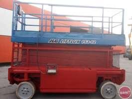 plataforma elevatórias de tesoura de rastos JLG 153-12 E 2002