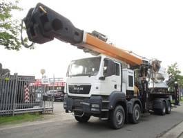 mounted boom lift truck MAN TGS 41.430 8X8 2011