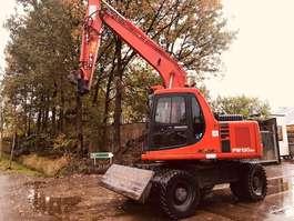 wheeled excavator Komatsu Komatsu  PW130