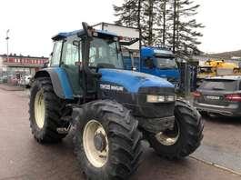 farm tractor New Holland TM135 2001