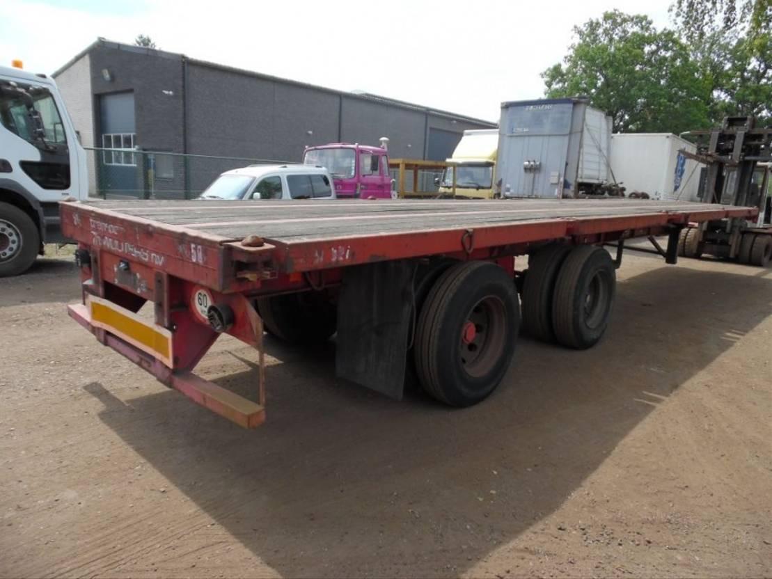 flatbed semi trailer Fruehauf 2-asser bladgeveerd 1987