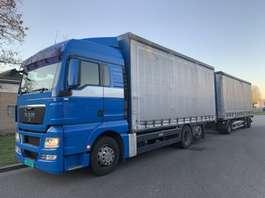 camión con cortina deslizante MAN TGX 26.480 6X2 COMBY 2009