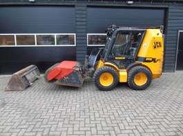 skid steer crawler loader JCB Robot 1105 schranklader met veegmachine bak bobcat 1999