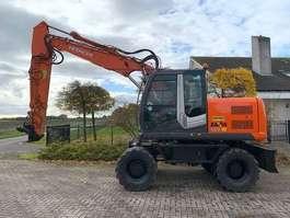 wheeled excavator Hitachi ZX 140 W-3 2009