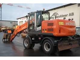 wheeled excavator Hitachi ZX 140 W-3 2011