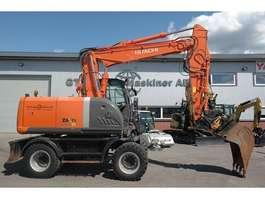 wheeled excavator Hitachi ZX 140 W-3 *Uthyres* 2011