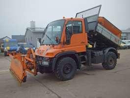 tipper truck Unimog U300 405/10 Aufsatzstreuer Schmidt SST17TL KLIMA 2003