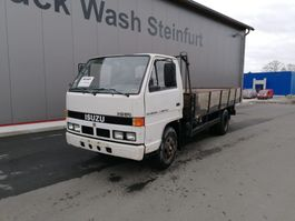 platform truck Isuzu NKR 3.6 - 7.500kg 1991