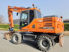 wheeled excavator Doosan DOOSAN DX140W 3   HIDRAULIC ROTATED UTILTY 2013