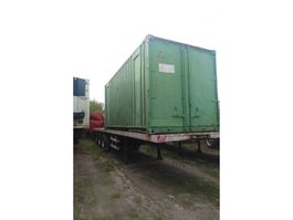 sliding curtain semi trailer Fruehauf Tri axle trailer on springs with twist locks for containers. 1987
