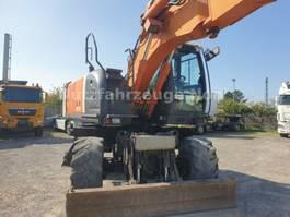 wheeled excavator Hitachi ZX140W-03 2008