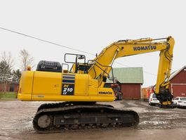 crawler excavator Komatsu PC210LC-11 with several tools 1974
