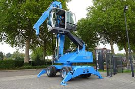 other excavators Fuchs MHL 320 Material Handler 2011
