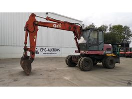 wheeled excavator O & K MH City 1990