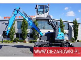 wheeled excavator Fuchs MHL 250 , 15t , roto , lift cab , hydraulic outputs , joystick , 2016