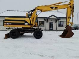 wheeled excavator Caterpillar M318 2000