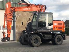 wheeled excavator Hitachi ZX140W 2009