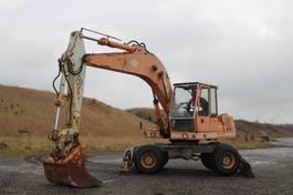 wheeled excavator O & K O & K MH 4. SERIE- G2. 1986