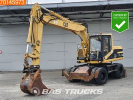 wheeled excavator Caterpillar M315 ALL FUNCTIONS - BLADE + STAMPS 1997