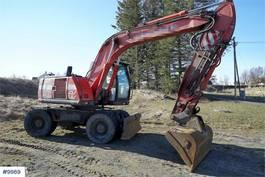 wheeled excavator O & K RH5 w / 3 buckets & stud hammer 2004