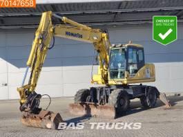 wheeled excavator Komatsu PW130- 7K BLADE + STAMPS - ALL FUNCTIONS 2005
