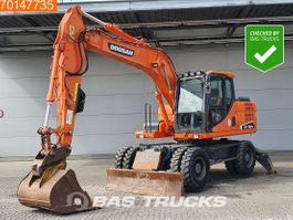 wheeled excavator Doosan DX160W-3 LOW HOURS - OUTRIGGERS AND BLADE 2015