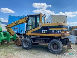 wheeled excavator Caterpillar M315 2000