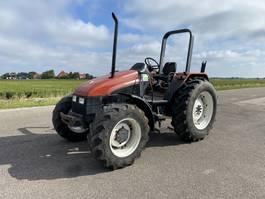 farm tractor New Holland L75 1997