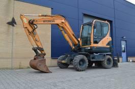 wheeled excavator Hyundai Robex 55W-9 - Mobiele graafmachine 2012