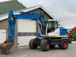 wheeled excavator Volvo EW140C 2008