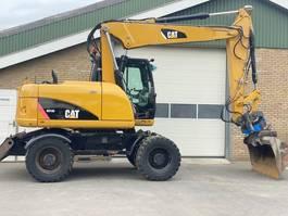 wheeled excavator Caterpillar M313D 2010